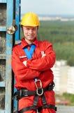 Erbauerarbeitskraft an der Baustelle Stockfotos