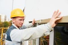 Erbauerfassade Plastererarbeitskraft Stockbild