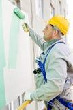Erbauerfassademaler bei der Arbeit Lizenzfreies Stockfoto