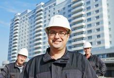 Erbauerteam an der Baustelle Stockbilder