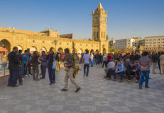 Erbil,Iraq. Erbil, Iraq - March 7, 2016:Old square in Erbil city crowded with people sitting inside and a guy selling licorice juice Stock Photo