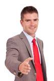 Erbjudande handskakning för affärsman Arkivfoto