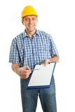 erbjudande papperen undertecknar teknikeren till Arkivbild