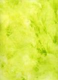 Erblassen Sie - grünen und gelben Aquarell-Hintergrund Stockbild