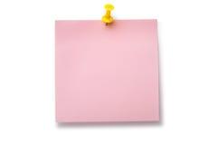 Erblassen Sie - rosafarbenen Aufkleber auf gelbem Thumbtack Lizenzfreie Stockfotografie