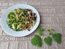 Erbsen mit Gemüse Lizenzfreie Stockbilder