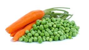Erbsen und Karotten Lizenzfreie Stockbilder