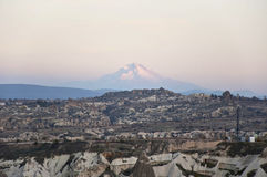 Erciyes. The Goreme National Park and mount Erciyes in Cappadocia at the evening Royalty Free Stock Photo