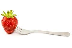 Erdbeere auf einer Gabel. Stockfotos
