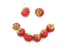 Erdbeerelächeln getrennt auf weißem Hintergrund Stockbilder