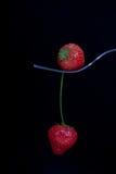 Erdbeeren auf einer Gabel Stockfotos