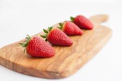 Erdbeeren an Bord Stockfoto