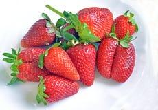 Erdbeeren und Orangen stockfotos