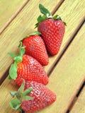 Erdbeeren und Orangen lizenzfreie stockbilder