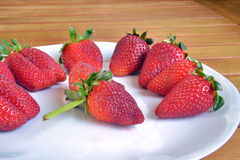 Erdbeeren und Orangen Stockfotografie