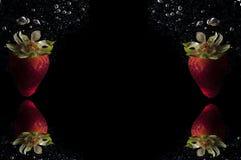Erdbeerfrucht-Spritzenhintergrund lizenzfreie stockfotografie