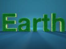 Erde buchstabierte durch die Buchstaben, die vom frischen grünen Gras auf blauem backg gemacht wurden Stockbild