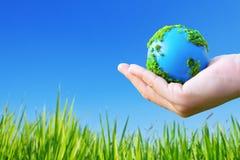 Erde in der Hand Lizenzfreies Stockbild