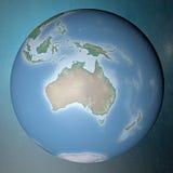Erde, die auf sauberem Raum Ozeanien steht Lizenzfreies Stockfoto
