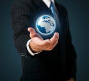 Erde in einer Hand Lizenzfreies Stockfoto