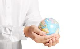 Erde im Menschen die Hand Lizenzfreie Stockbilder