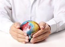 Erde im Menschen die Hand Lizenzfreies Stockbild