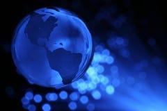 Erde-Kugel und Faseroptik lizenzfreie stockbilder