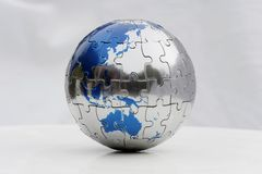Erde-Puzzlespiel Stockfoto