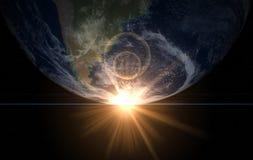 Erde und Sonne. Platzsonnenaufgang Amerika Stockbilder