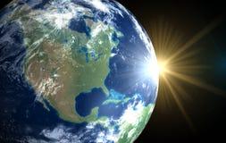 Erde und Sonne. Platzsonnenaufgang Amerika Stockfotografie