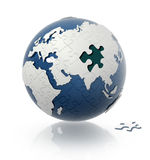 Erdekugel mit Puzzlespielmuster. Lizenzfreies Stockbild