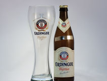 Erdinger beer. Bottle with empty glass isolated on white background Stock Photography