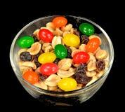 Erdnüsse, Rosinen und Geleebonbons Stockbilder