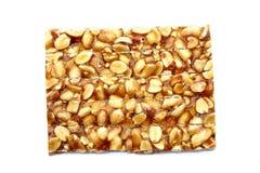 Erdnusssprödes auf weißem Hintergrund Lizenzfreie Stockbilder