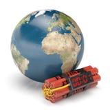 Erdplanet mit DynamitZeitbombe Lizenzfreies Stockfoto