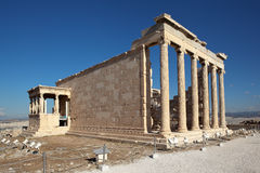 Erechtheion, Acropolis. Athens. Greece. Athens, Greece - May 6 2016: Stone building with columns. Around the building strolling tourists. Parthenon - a monument Royalty Free Stock Photos