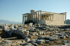 The Erechtheion or Erechtheum. Is an ancient Greek temple on the north side of the Acropolis of Athens in Greece which was dedicated to both Athena and Poseidon Royalty Free Stock Photo