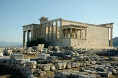 The Erechtheion or Erechtheum. Is an ancient Greek temple on the north side of the Acropolis of Athens in Greece which was dedicated to both Athena and Poseidon Stock Images
