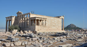 Erechtheion temple and Mount Lycabettus royalty free stock photography