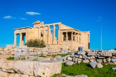 The Erechtheion or Erechtheum is an ancient Greek temple on the north side of the Acropolis of Athens in Greece stock photography