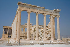 Erechtheum on the Acropolis, athens. The Erchtheum showing the Porch of the Caryatids (six maidens) - to the left hand side - on the Acropolis in Athens, Greece stock images
