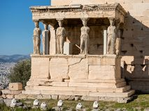 The Erechtheum with Caryatids in Acropolis. The Erechtheum with caryatids near Parthenon temple in Acropolis hill Royalty Free Stock Images