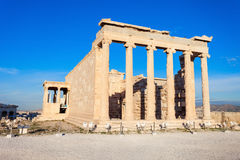 Erechtheum Temple in Athens. The Erechtheion or Erechtheum is an ancient Greek temple on the Acropolis of Athens in Greece which was dedicated to both Athena and Royalty Free Stock Images