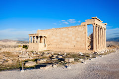 Erechtheum Temple in Athens. The Erechtheion or Erechtheum is an ancient Greek temple on the Acropolis of Athens in Greece which was dedicated to both Athena and Royalty Free Stock Photo