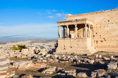 Erechtheum Temple in Athens. The Erechtheion or Erechtheum is an ancient Greek temple on the Acropolis of Athens in Greece which was dedicated to both Athena and Royalty Free Stock Image