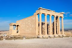 Erechtheum Temple in Athens. The Erechtheion or Erechtheum is an ancient Greek temple on the Acropolis of Athens in Greece which was dedicated to both Athena and Stock Photo