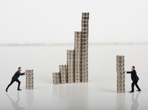 Erect a construction. Business person built together a construction with magnets royalty free stock images
