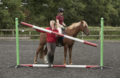 Erecting a riding school jump Royalty Free Stock Image