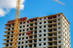 The erection of high-rise apartment buildings stock image