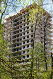 The erection of a high-rise multi-apartment building in the forest royalty free stock image